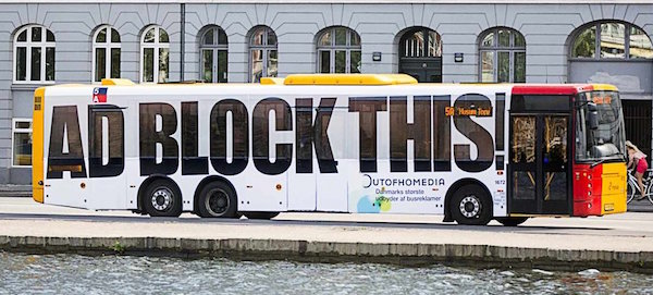"bus emblazoned with ""adblock this!"""