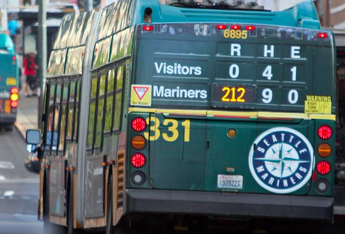 bus ad where bus number forms part of imaginary baseball scoreboard