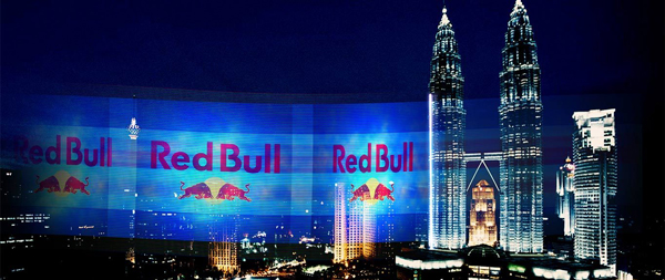 Red bull digital billboard dominating night sky