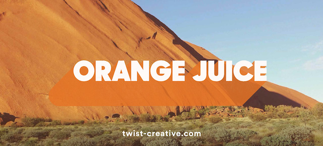 The words 'orange juice' on a scenic background