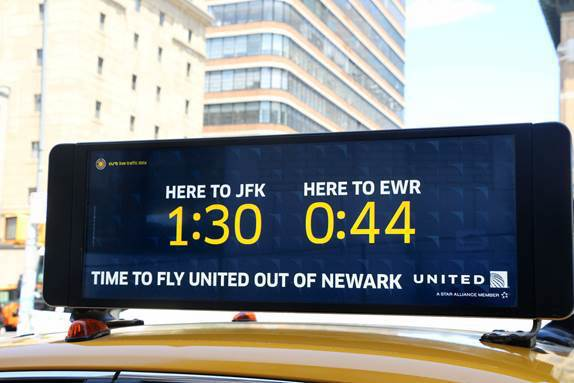 Taxi sign: Here to JFK 1:30 Here to EWR 0:44