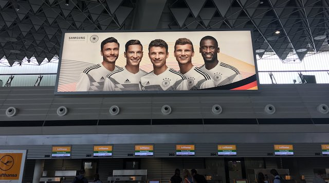 German team on outdoor ad at airport
