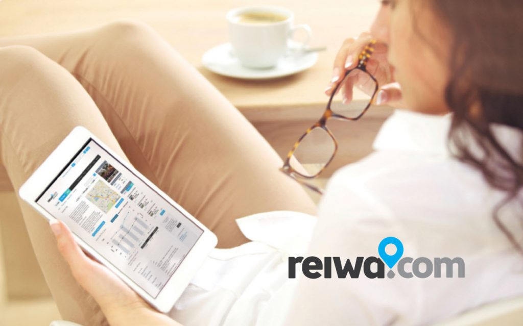 Lady reclining, browsing real estate on tablet