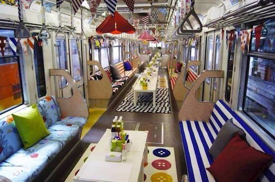 interior of colourful, decorated train carriage