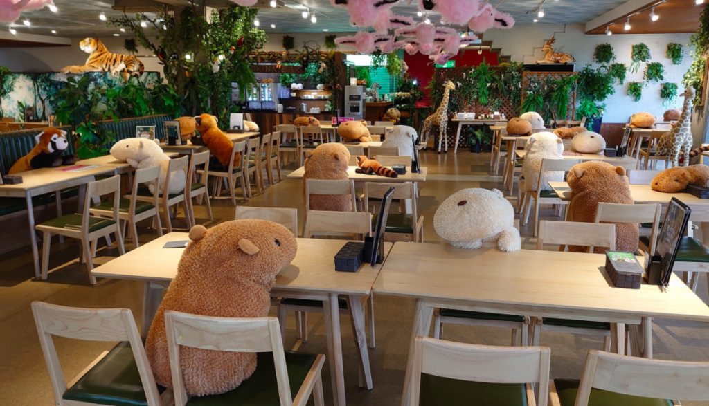 Large stuffed toys occupying seats in restaurant