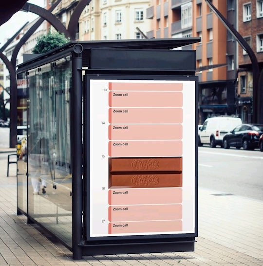 Bus ad showing hourly schedule of Zoom calls with kitkat bar slotted into the middle